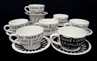 The coffee cup 'pages' have the words of various coffee lovers